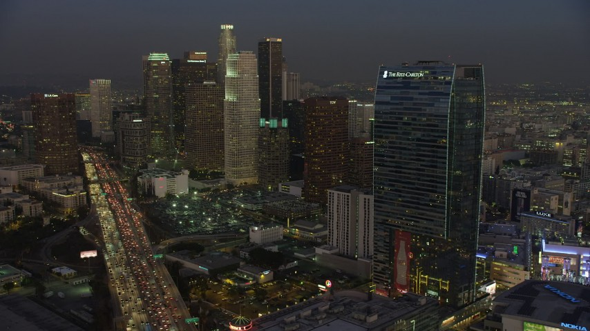5K stock footage aerial video of 110 Freeway, Downtown Los Angeles skyscrapers, The Ritz-Carlton, California, twilight Aerial Stock Footage | AX64_0224