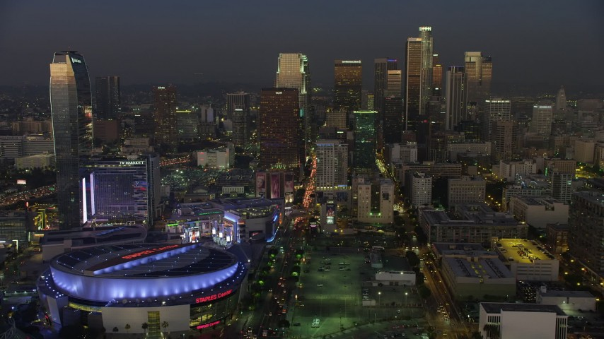 5K stock footage aerial video of Downtown Los Angeles skyscrapers behind Staples Center and Ritz-Carlton, California, twilight Aerial Stock Footage | AX64_0226