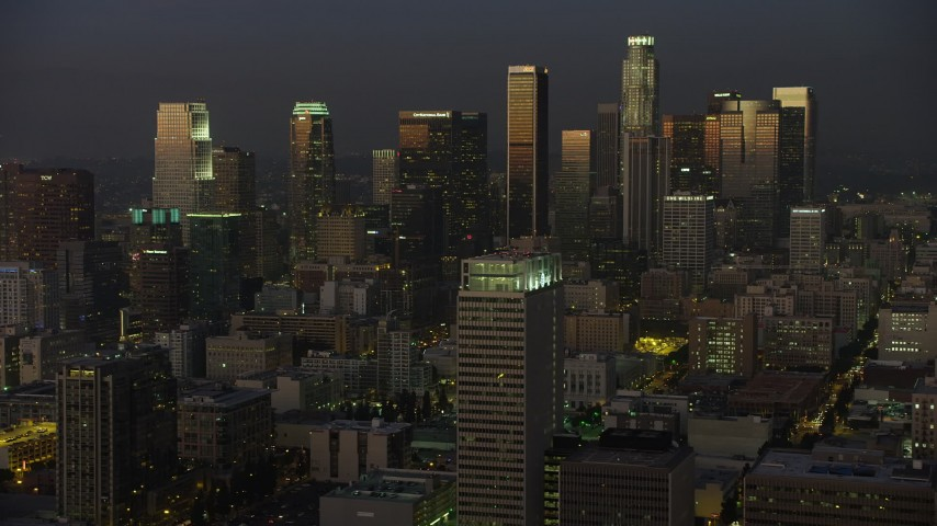5K aerial video of Downtown Los Angeles skyscrapers reflecting the twilight light, California Aerial Stock Footage | AX64_0228