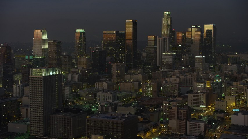 5K aerial video of Downtown Los Angeles high-rises reflecting the twilight, California Aerial Stock Footage | AX64_0229