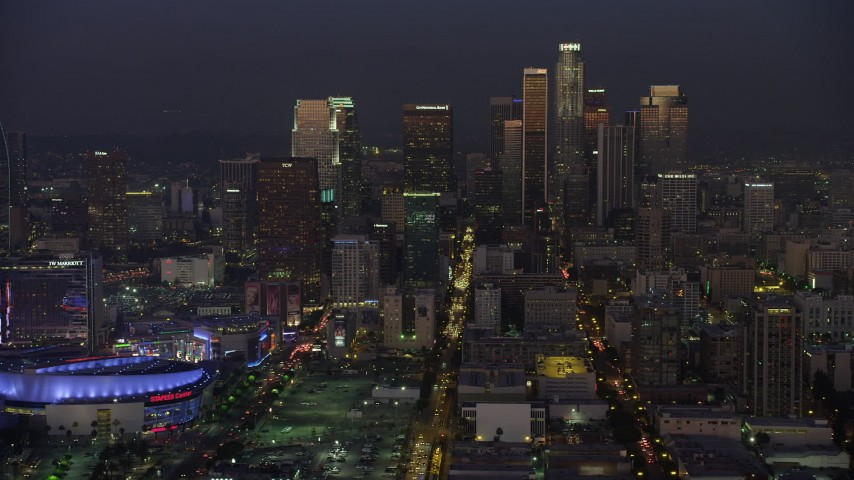 5K stock footage aerial video of Downtown Los Angeles skyscrapers and reveal Staples Center arena, California, twilight Aerial Stock Footage | AX64_0232