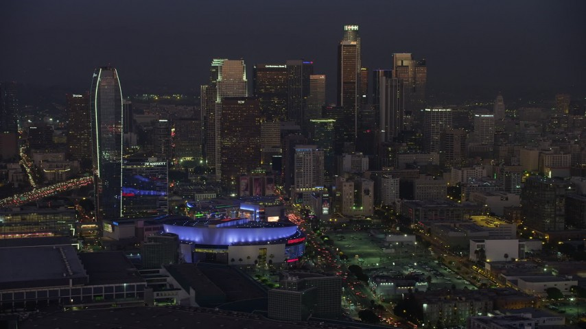 5K stock footage aerial video of Staples Center arena, hotels and skyscrapers in Downtown Los Angeles, California, twilight Aerial Stock Footage | AX64_0233