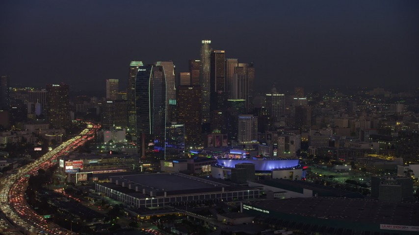 5K aerial video of Staples Center, downtown skyscrapers and hotels, and 110 Freeway, Los Angeles California, twilight Aerial Stock Footage | AX64_0234