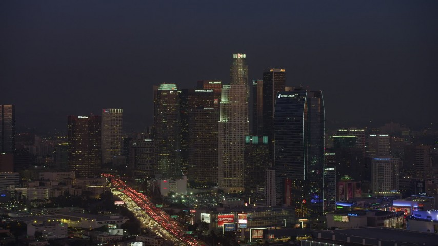 5K aerial video of Downtown Los Angeles towers and 110 freeway, California, twilight Aerial Stock Footage | AX64_0235
