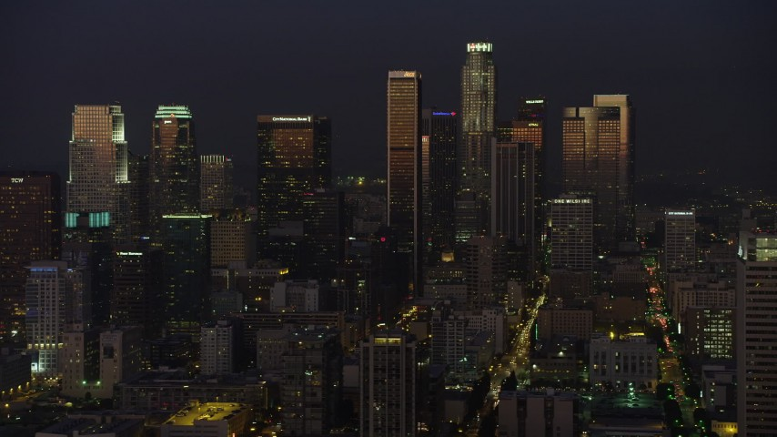 5K stock footage aerial video of towering skyscrapers in Downtown Los Angeles, California, twilight Aerial Stock Footage | AX64_0239
