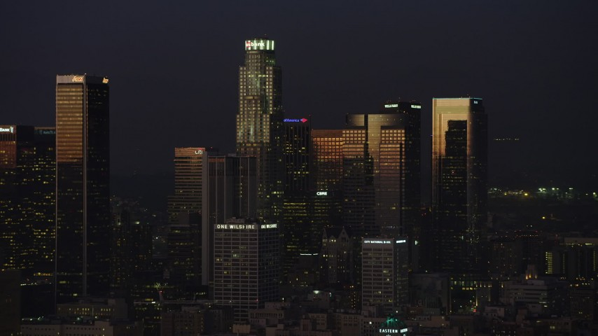 5K stock footage aerial video of US Bank Tower and skyscrapers in Downtown Los Angeles, California, twilight Aerial Stock Footage | AX64_0240