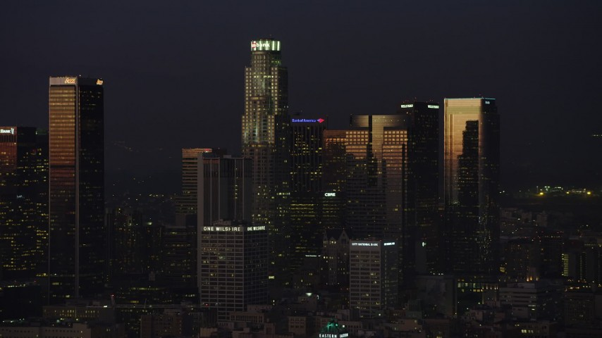 5K stock footage aerial video of US Bank Tower and neighboring high-rises in Downtown Los Angeles, California, twilight Aerial Stock Footage | AX64_0241