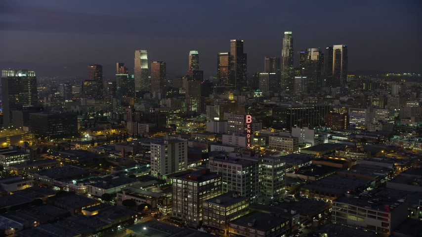 5K stock footage aerial video approach Downtown Los Angeles office buildings and skyscrapers, California, twilight Aerial Stock Footage | AX64_0243