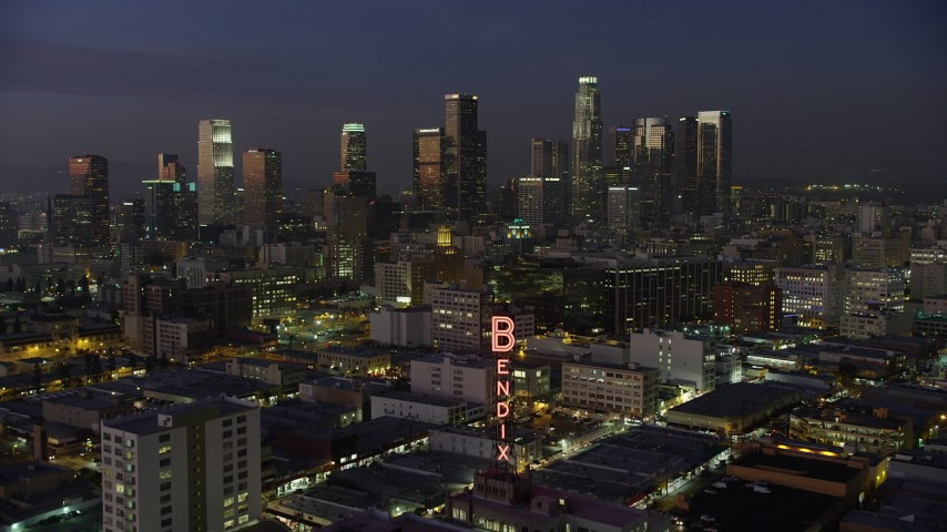 5K stock footage aerial video approach Bendix Sign and Downtown Los Angeles skyscrapers, California, twilight Aerial Stock Footage | AX64_0244