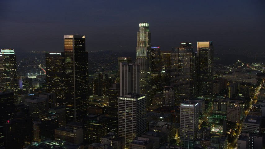 5K stock footage aerial video approach 611 Place and US Bank Tower in Downtown Los Angeles, California, twilight Aerial Stock Footage | AX64_0247