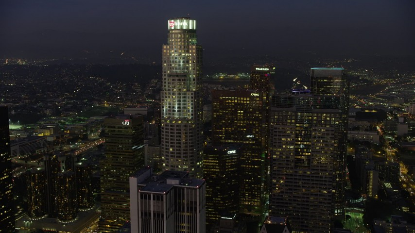 5K stock footage aerial video fly over 611 Place to approach US Bank Tower, Downtown Los Angeles, California, twilight Aerial Stock Footage | AX64_0248