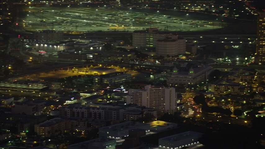 5K stock footage aerial video of tracking a police helicopter flying over Downtown Los Angeles, California, Night Aerial Stock Footage | AX64_0251