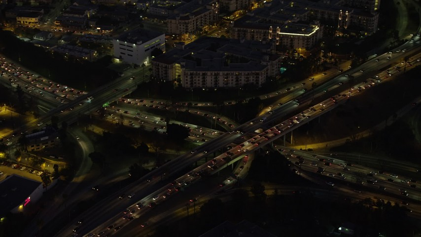 5K aerial video of heavy traffic on Highway 110 and 101 interchange, Downtown Los Angeles, California, Night Aerial Stock Footage | AX64_0252