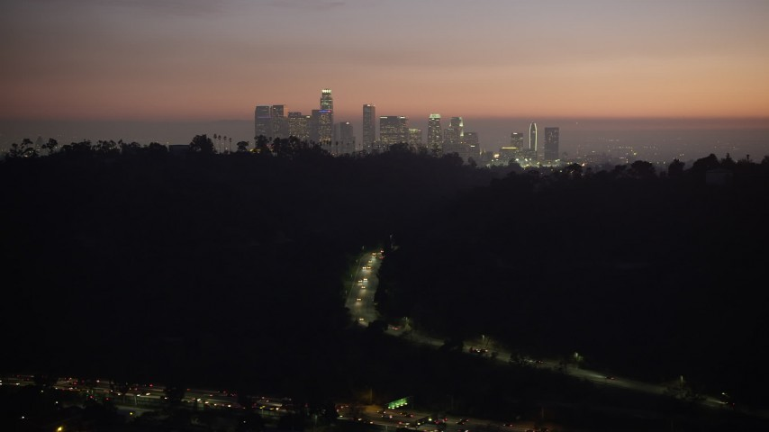 5K stock footage aerial video of Downtown Los Angeles skyline seen from Elysian Park, California, twilight Aerial Stock Footage | AX64_0257
