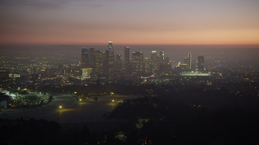 5K stock footage aerial video of the Downtown Los Angeles skyline at twilight in California Aerial Stock Footage | AX64_0259