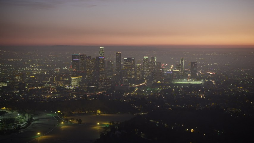 5K stock footage aerial video of a view of Downtown Los Angeles skyscrapers at twilight, California Aerial Stock Footage | AX64_0260