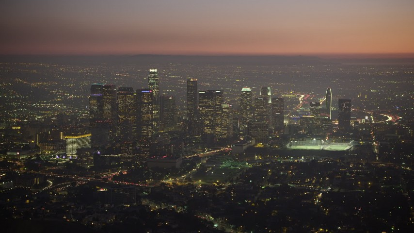 5K stock footage aerial video of an approach to Downtown Los Angeles skyscrapers in California at twilight Aerial Stock Footage | AX64_0261