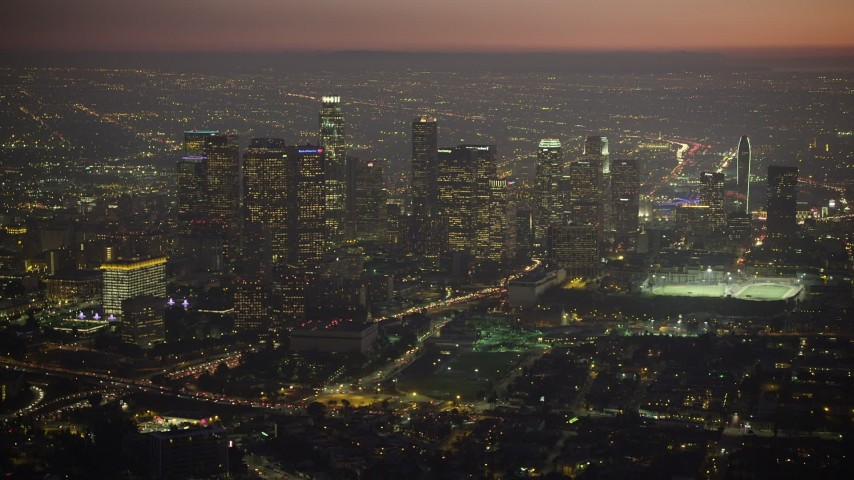 5K aerial video approach Downtown Los Angeles skyscrapers at twilight in California Aerial Stock Footage | AX64_0262