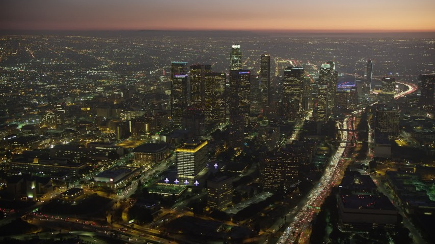 5K stock footage aerial video of Downtown Los Angeles skyscrapers, concert halls, and the 110 freeway, California, twilight Aerial Stock Footage | AX64_0264