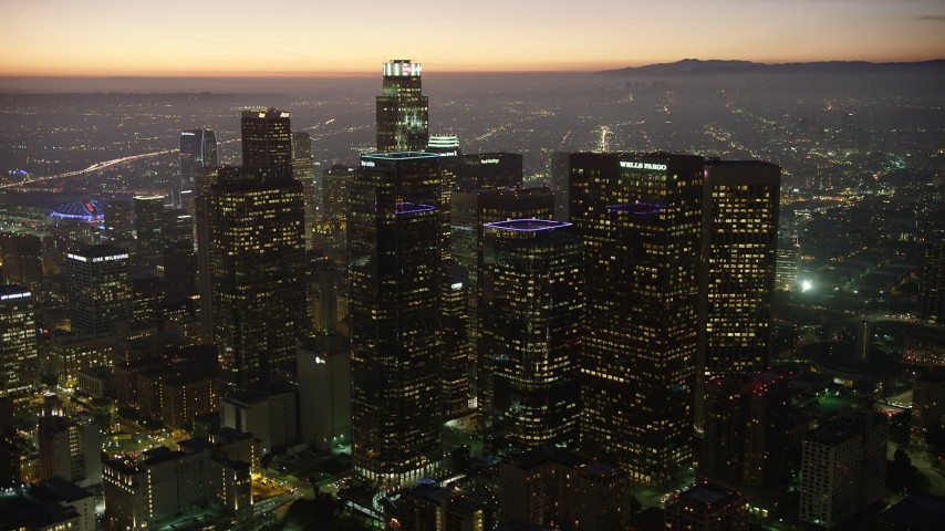 5K stock footage aerial video flyby Downtown Los Angeles' tall skyscrapers, California at twilight Aerial Stock Footage | AX64_0267