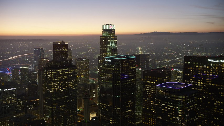 5K aerial video approach Two California Plaza and US Bank Tower, Downtown Los Angeles, California, twilight Aerial Stock Footage | AX64_0268
