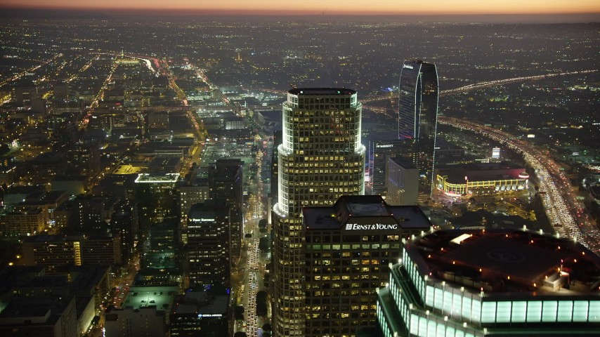 5K stock footage aerial video approach the top of 777 Tower and reveal Staples Center in Downtown Los Angeles, California, twilight Aerial Stock Footage | AX64_0270