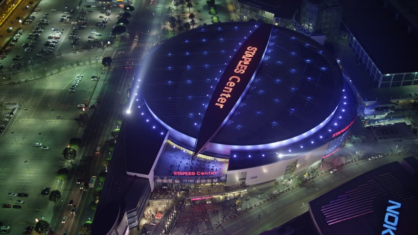 5K stock footage aerial video tilt to a bird's eye view of Staples Center, Downtown Los Angeles, California, night Aerial Stock Footage | AX64_0272