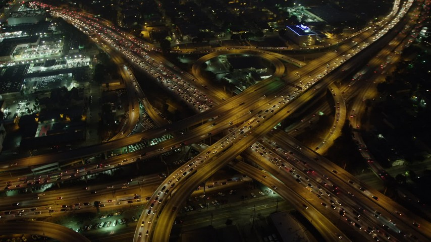 5K stock footage aerial video of I-10 and 110 freeway interchange with heavy traffic, Downtown Los Angeles, California, night Aerial Stock Footage | AX64_0273