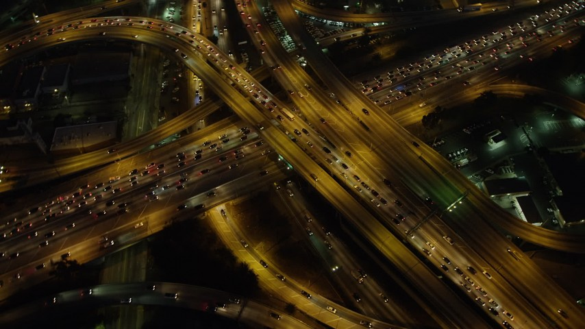 5K stock footage aerial video of bird's eye view of traffic on the I-10 and 110 interchange, Downtown Los Angeles, California, night Aerial Stock Footage | AX64_0274