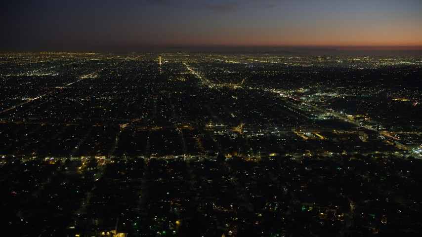 5K stock footage aerial video of West Adams neighborhood around Crenshaw Boulevard in Los Angeles, California, night Aerial Stock Footage AX64_0279 | Axiom Images