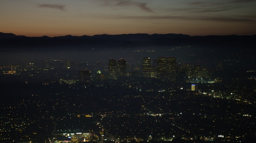 5K stock footage aerial video of Century City skyscrapers at night in Los Angeles, California Aerial Stock Footage | AX64_0281