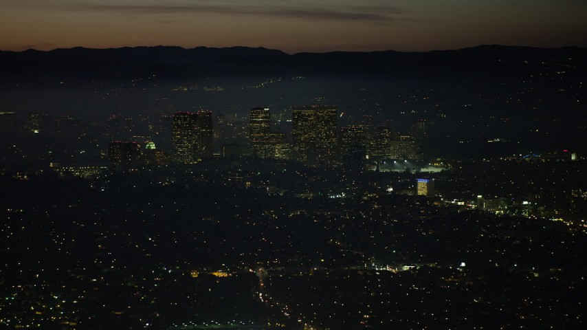 5K stock footage aerial video of Century City skyscrapers and high-rises in Los Angeles, California, night Aerial Stock Footage | AX64_0282