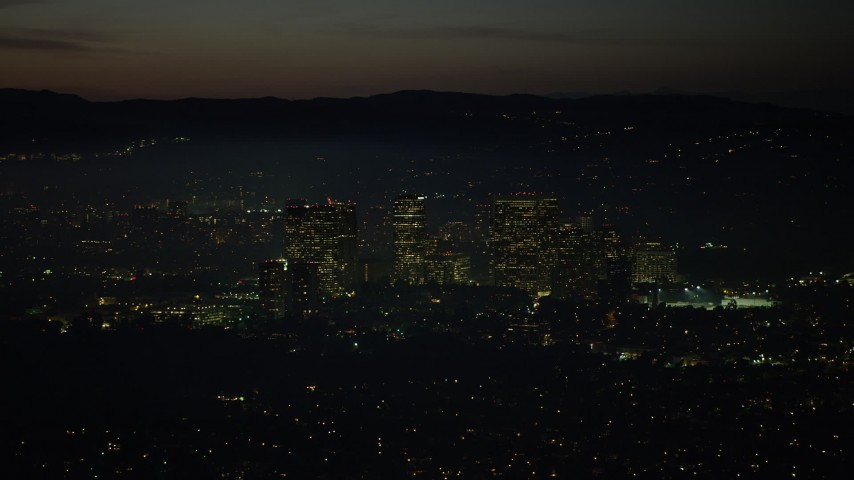 5K stock footage aerial video of passing Century City skyscrapers at night, Los Angeles, California Aerial Stock Footage | AX64_0284