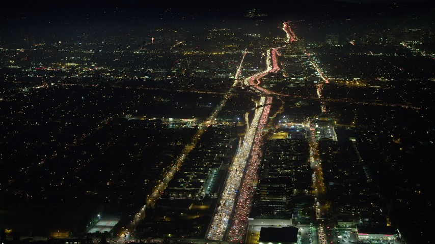 5K stock footage aerial video of heavy traffic on I-405 freeway through Sawtelle, Los Angeles, California, night Aerial Stock Footage | AX64_0290