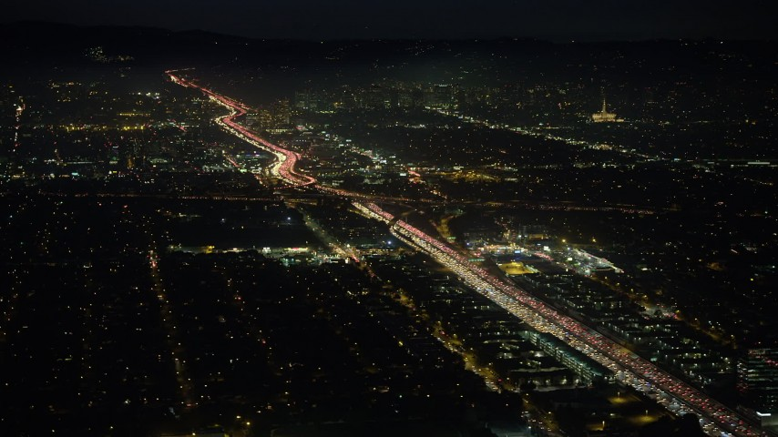 5K stock footage aerial video of Interstate 405 freeway with heavy traffic in Sawtelle, Los Angeles, California, night Aerial Stock Footage | AX64_0291