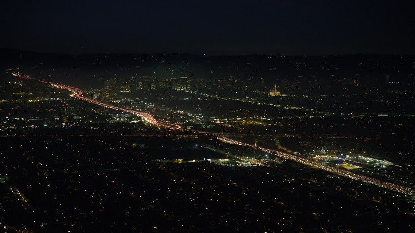 5K stock footage aerial video of a view of heavy traffic on Interstate 405 in Sawtelle, Los Angeles, California, night Aerial Stock Footage | AX64_0292