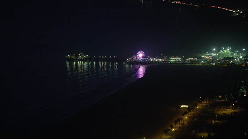 5K stock footage aerial video of approaching iconic Santa Monica Pier and the Pacific Wheel at night, Los Angeles, California Aerial Stock Footage | AX64_0298