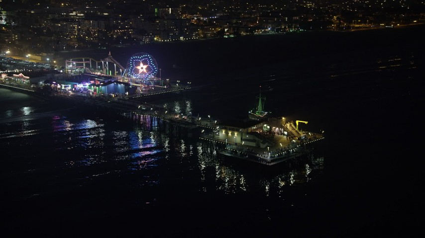 5K stock footage aerial video flyby the Santa Monica Pier and ferris wheel, Los Angeles, California, night Aerial Stock Footage | AX64_0304
