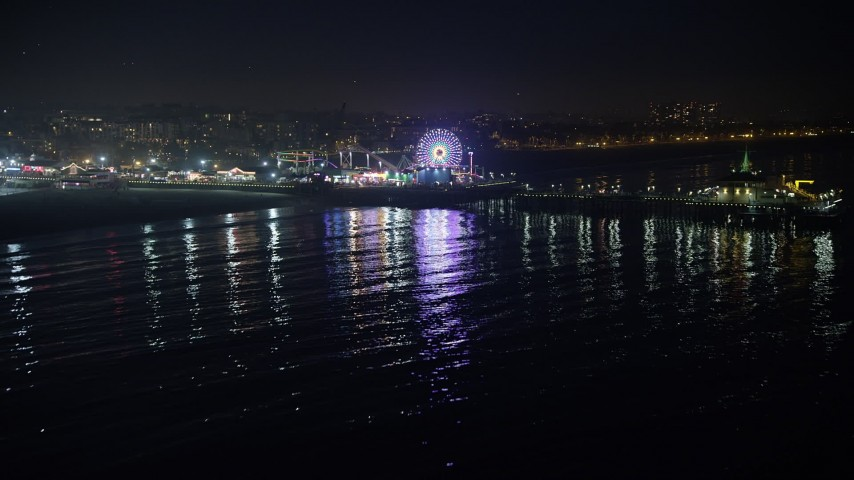 5K stock footage aerial video approach the Pacific Wheel at Santa Monica Pier, Los Angeles, California, night Aerial Stock Footage | AX64_0306