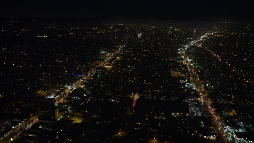 5K stock footage aerial video of flying between Santa Monica and Wilshire Boulevards, Santa Monica, California, night Aerial Stock Footage | AX64_0313