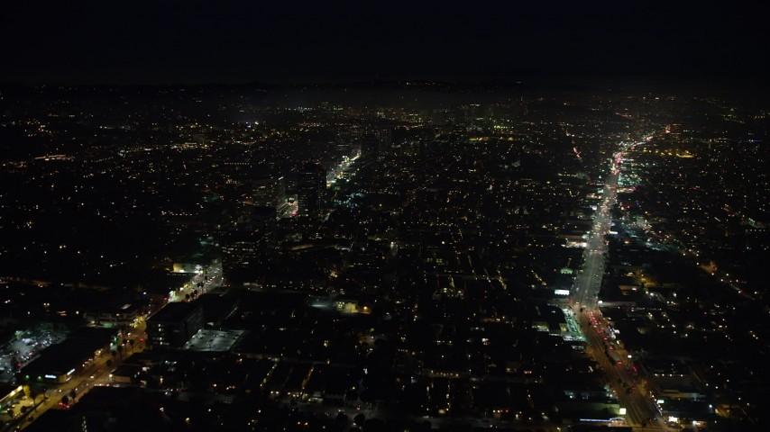5K stock footage aerial video of buildings between Santa Monica and Wilshire Boulevards, Santa Monica, California, night Aerial Stock Footage | AX64_0314