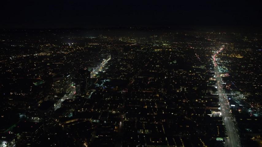5K stock footage aerial video of dark buildings between Santa Monica and Wilshire Boulevards, Santa Monica, California, night Aerial Stock Footage | AX64_0315