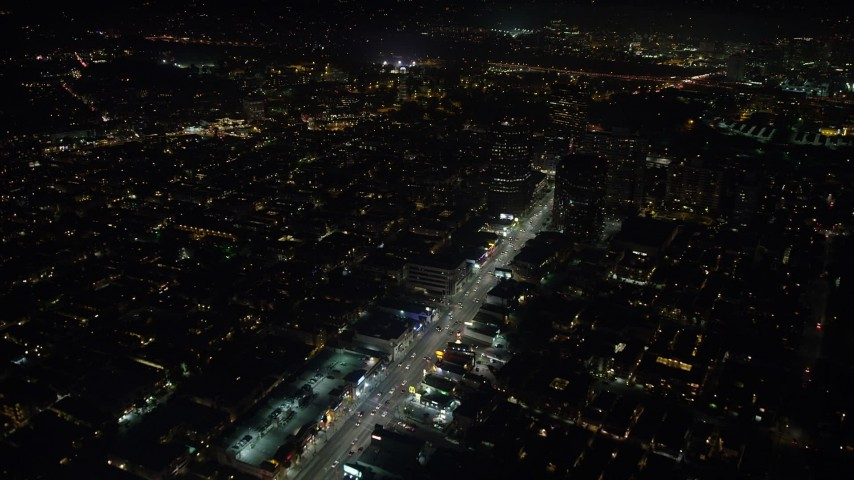 5K stock footage aerial video of following Wilshire Boulevard toward office buildings in Sawtelle, Los Angeles, California at night Aerial Stock Footage | AX64_0316