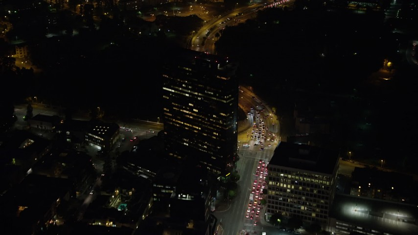 5K stock footage aerial video fly over Wilshire Boulevard and a tall office building at night, Sawtelle, Los Angeles, California Aerial Stock Footage | AX64_0317