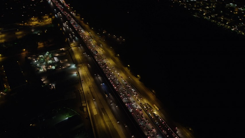 5K stock footage aerial video of heavy traffic on Interstate 405 in Westwood, Los Angeles, California, night Aerial Stock Footage | AX64_0318