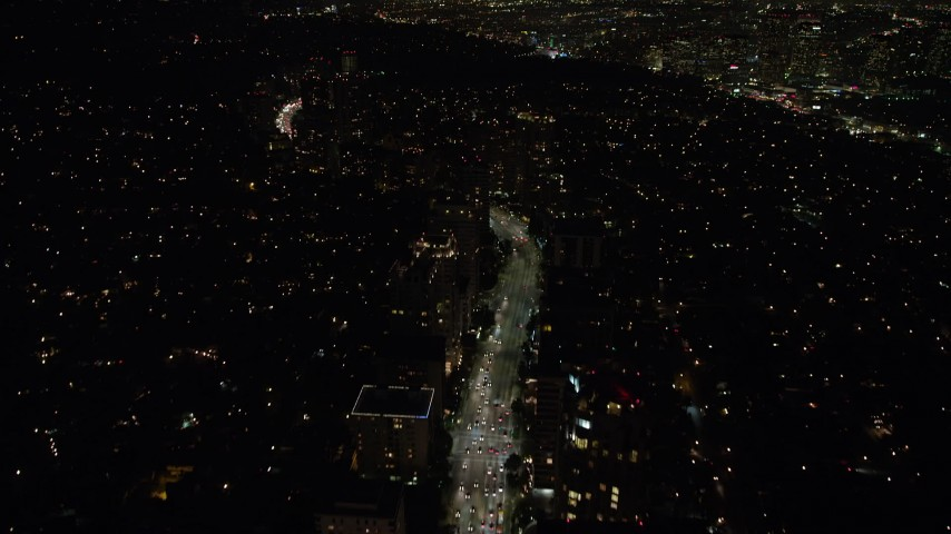 5K stock footage aerial video of Wilshire Boulevard and condominium complexes in Westwood, Los Angeles, California, night Aerial Stock Footage | AX64_0320