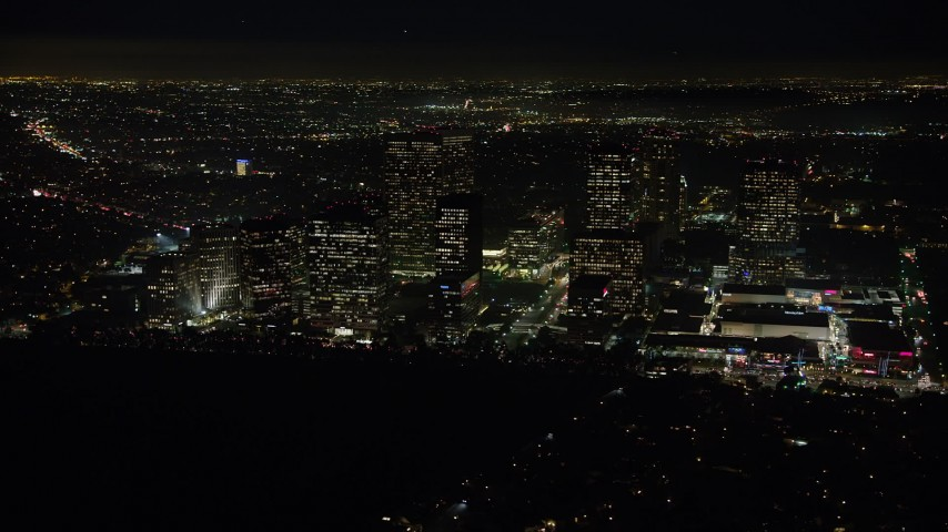 5K stock footage aerial video of passing by Century City skyscrapers, Los Angeles, California, night Aerial Stock Footage | AX64_0322