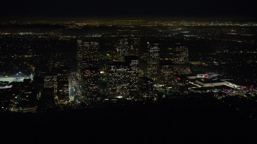 5K stock footage aerial video of skyscrapers in the Century City area of Los Angeles, California, night Aerial Stock Footage | AX64_0323