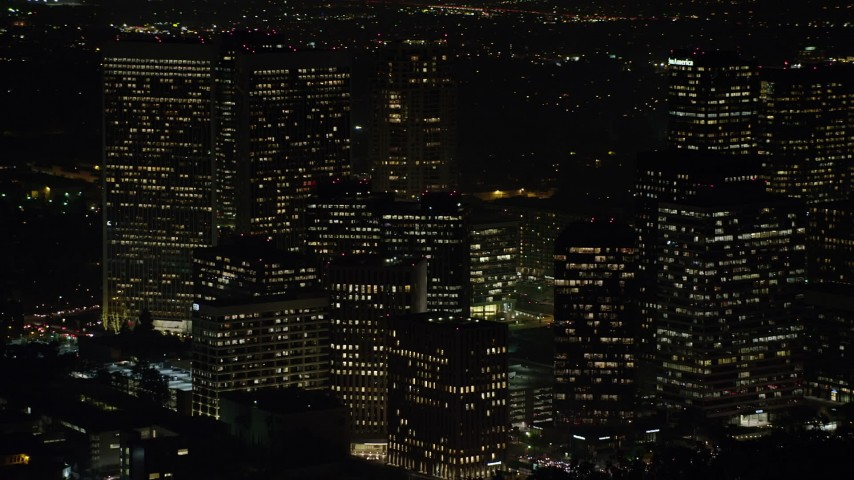 5K stock footage aerial video of reverse view of Century City Skyscrapers, Los Angeles, California, night Aerial Stock Footage | AX64_0324