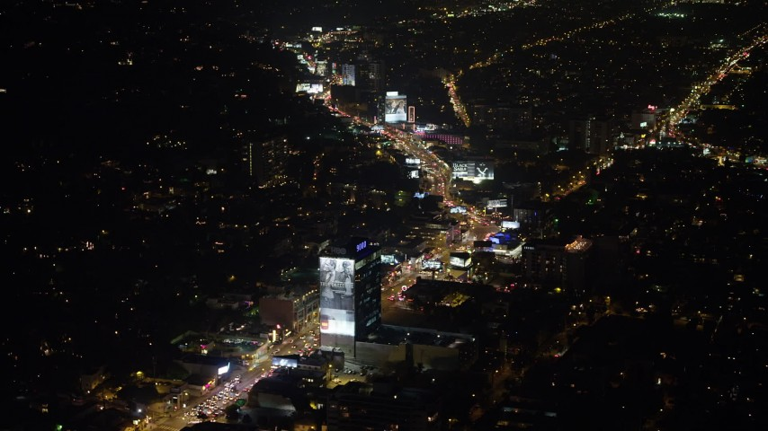 5K stock footage aerial video approach and tilt to the Sunset Strip, West Hollywood, California, night Aerial Stock Footage   AX64_0327